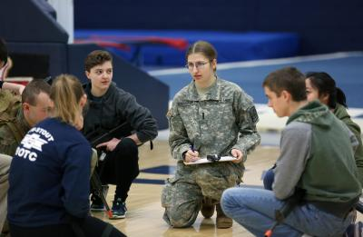 Allegra Van Rossum and other Stout students participating in a ROTC training.