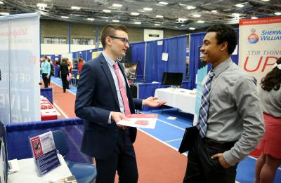 Photo of student being interviewed at Spring Career Fair.