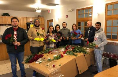 Fedi Soltani and other UW-Stout students preparing for Rose Delivery Day.