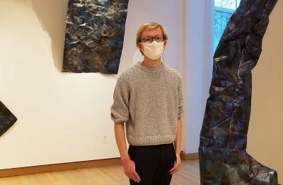 Studio arts senior and gallery assistant Beck Slack in Furlong Gallery.