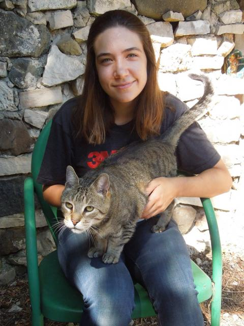 Mary Benetti, game design and development senior, with her cat at her home in Pewaukee.